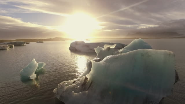 AERIAL Icebergs in the lagoon at sunset video