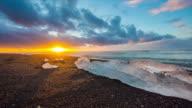 T/L Icebergs on black beach at sunrise video
