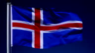 4K: Icelandic Flag on Flagpole in front of Blue Sky outdoors (Iceland) video