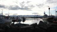 Icelandic harbor Husavik with fishing boats at dusk video