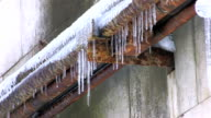 Icicles hanging from rusty pipe video