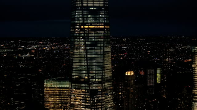 AERIAL, CLOSE UP: Iconic Downtown Manhattan skyline lit up with lights at night video