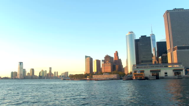 Iconic Lower Manhattan skyline at golden sunset and New Jersey in the distance video