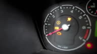 Icons lighting up on a car's dashboard video