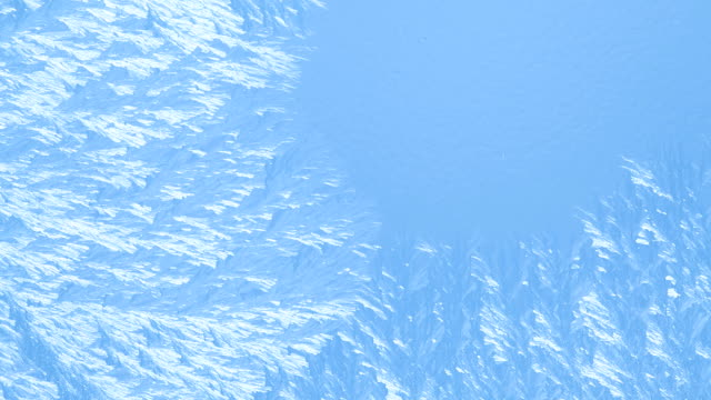 Icy blue background of freezing water on the glass video