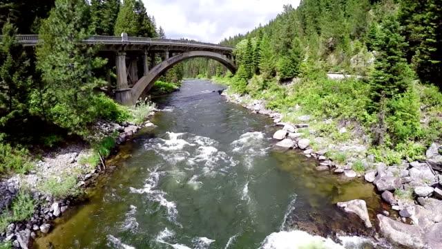 Idaho river with a historic bridge crossing video