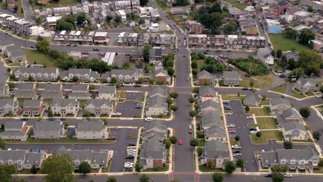 AERIAL: Identical perfect row houses in stunning suburban town near busy highway video