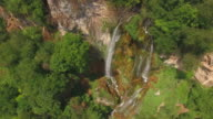Idyllic place with waterfall / Aerial video