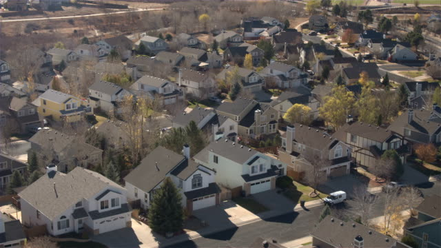 AERIAL, CLOSE UP: Idyllic suburban village with new row houses on sunny fall day video
