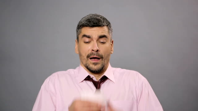 Ill man sneezing in paper napkin, sickness and health-care,  health problems video