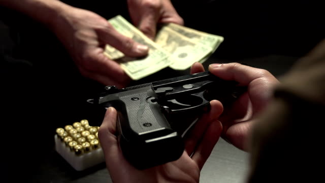 Illegal gun trade between two men video