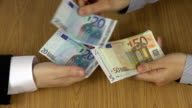 Illegal payment for works. Hand give euro banknotes. video
