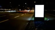 Illuminated billboard - night traffic, time lapse video