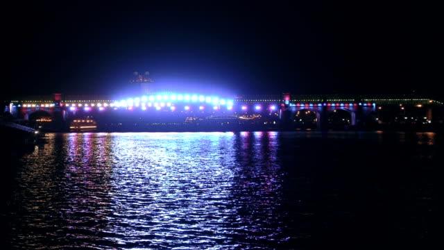 Illuminated bridge and light show video