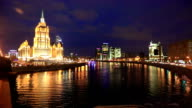 Illuminated building of Hotel Ukraina and Moscow river at night video