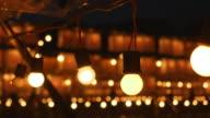 Illuminated light bulbs at festival video