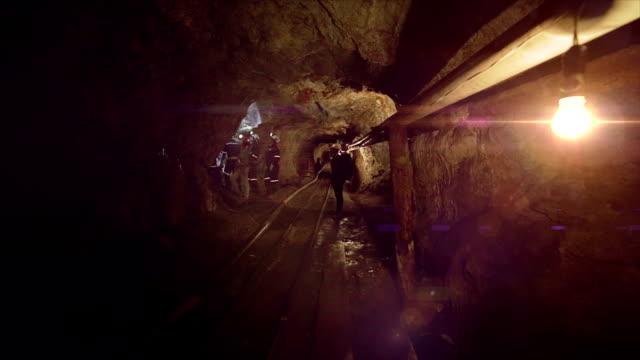 Illuminated long tunnel of a mine video
