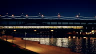 Illuminated subway bridge over Moscva river at night video