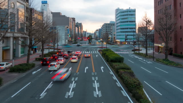 Illuminated traffic car trail time-lapse at sunset video
