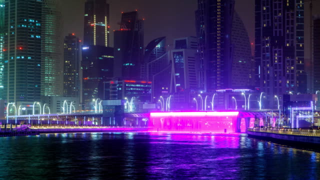 Illuminated Waterfall at the Sheikh Zayed Bridge timelapse, part of the Dubai Water Canal. Dubai, United Arab Emirates, Middle East video