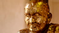 image of famous monk is decorated with gold leaf video