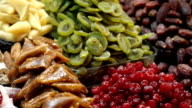 Image of market offering a selection of dried fruits video