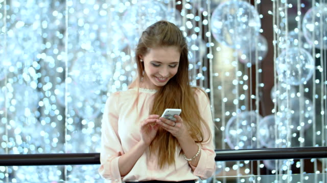 Image of young female using cellular phone video