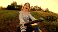 HD Image Sequence. GENDER NEUTRAL KIDS. A Happy Little Girl Drive Go-chart, Off-Road. Happy Memories Of Her Young Days video