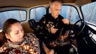 Image Sequence.Eastern Europe Street Fashion. Couple Dress Up In Small Car. video