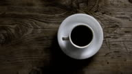 Imitation movement of the sun, sunrise, day, sunset, the movement of the shadows of the cup with coffee, tea video