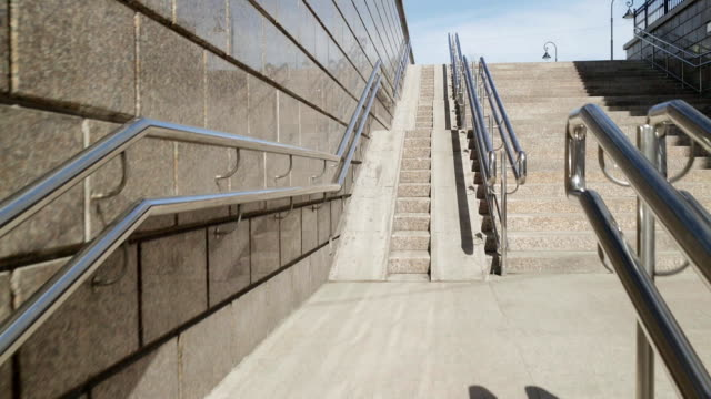 Imitation of a lift in motion on a large ramp for wheelchairs in motion video