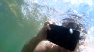 VR Immersive Reality: Man submerges with headset in tropical lagoon video