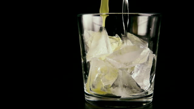In a glass with ice pour the juice and vodka. Slow motion video