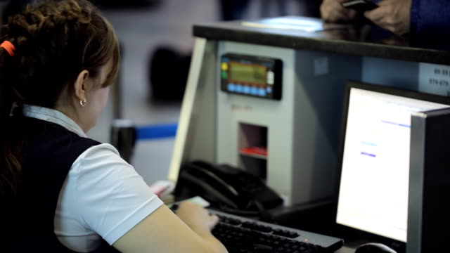 In airport woman is working with computer sitting in reception area video