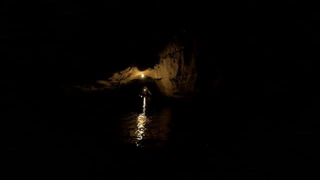 In Halong Bay in Hanoi, Vietnam seen river and dark grotto video