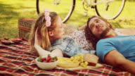 In high quality 4k format cute couple having picnic video