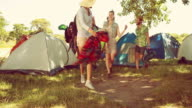 In high quality 4k format friends arriving at music festival video