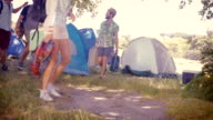 In high quality format young friends arriving at their campsite video