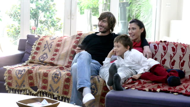 In holiday happy Turkish family watching tv at home video