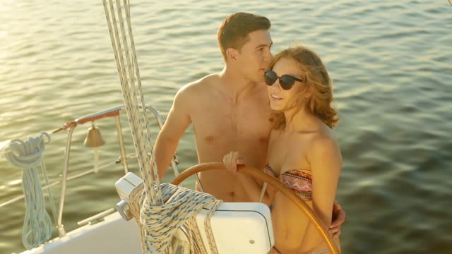 In love couple relaxing on a yacht. video