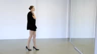 In model school female is walking up and down with jacket video