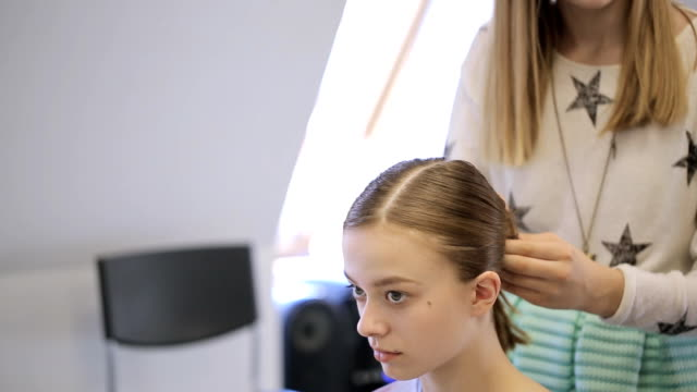 In model school woman is making bundle on teenage head video