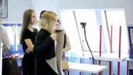 In model school young females are getting ready for fashion show video