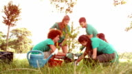 In slow motion happy friends gardening for the community video