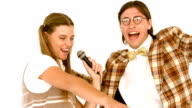 In slow motion happy geeky hipsters singing with microphone video