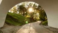In the arch of the bridge. Autumn daytime. Smooth dolly shot. video