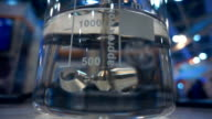 In the chemical laboratory glass flask with transparent liquid are mixed video
