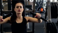In the gym beautiful woman performs a bench press from the chest video