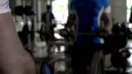 In the gym young man doing exercises video