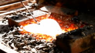 In the hearth are forged components for metallic flower video